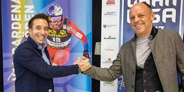 Andy Varallo und Rainer Senoner beglückwünschen die Olympia-Orte von 2026 (Foto: © Saslong.org)