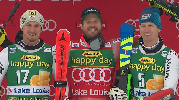Max Franz und Hannes Reichelt beim Super-G in Lake Louise, neben Kjetil Jansrud auf dem Podium